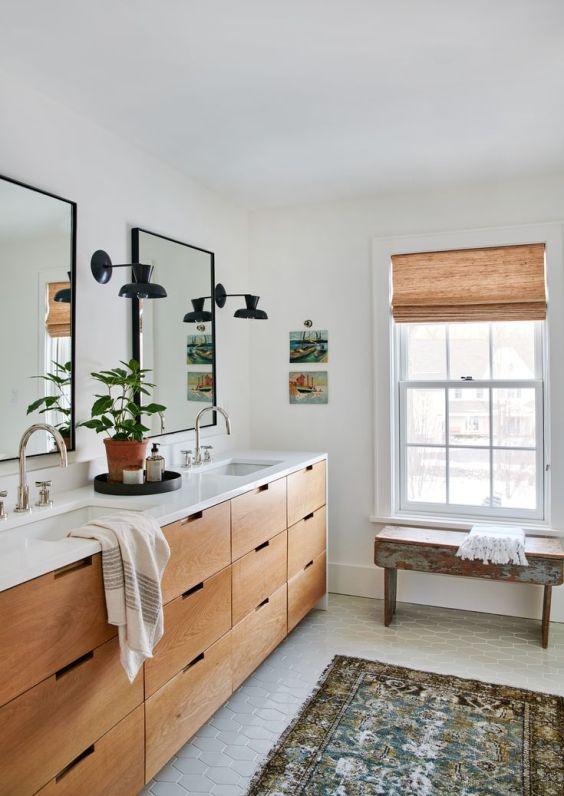 Beautiful bathroom design idea with light wood vanity, vintage rug, and black sconces - bathroom decor - bathroom remodel -Amber Interior Design   Photo by Tessa Neustadt