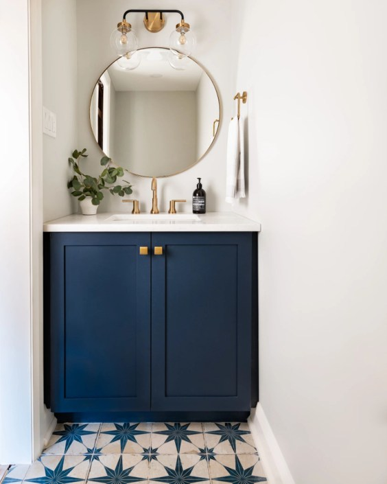Powder bath with navy blue vanity and patterned tile - West of Main - bathroom ideas - guest bathroom - bathroom decor - bathroom design - blue bathroom cabinets