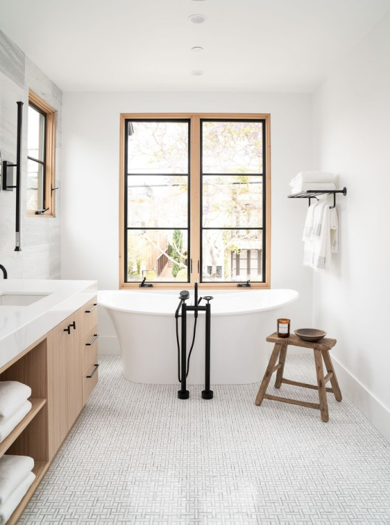 Beautiful modern bathroom design with light wood cabinetry and free standing tub - Design Works - bathroom ideas - bathroom decor - bathroom remodel