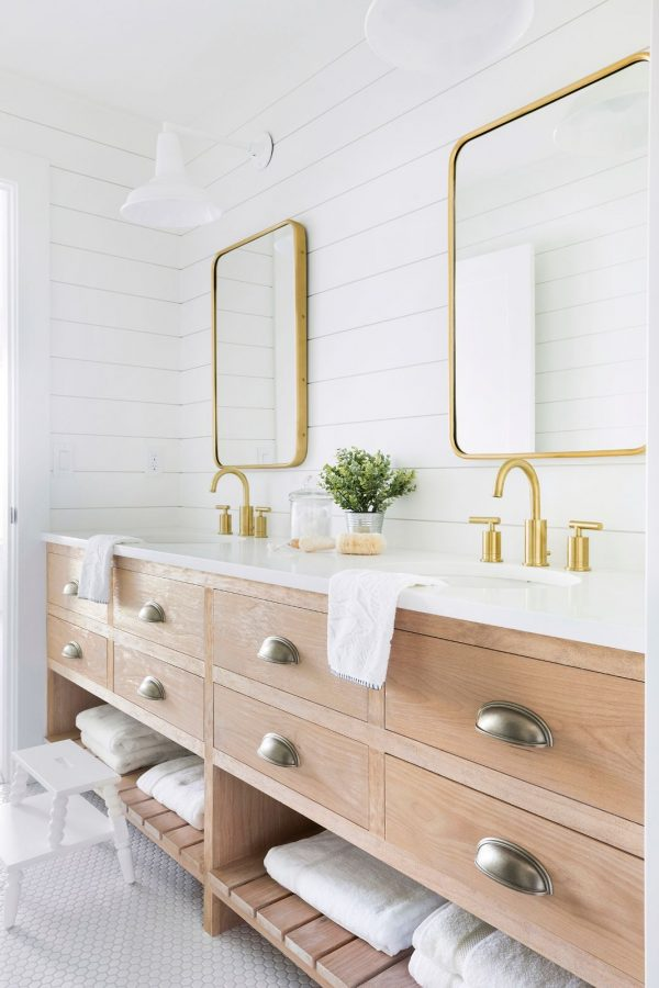 Beach house bathroom with light wood vanity and shiplap walls