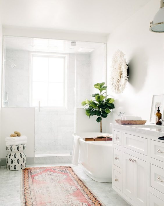Love this beautiful white bathroom design with glass shower enclosure, free standing tub and colorful vintage Turkish runner - bathroom ideas - bathroom remodel - bathroom decor