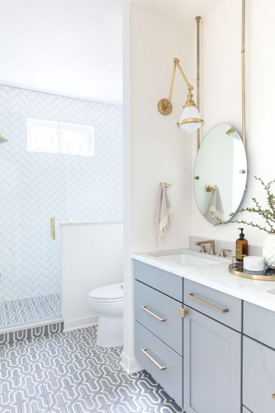 So many beautiful ideas in this gorgeous bathroom! I love the soft blue vanity color and patterned tile floor - bathroom remodel - bathroom ideas - bathroom decor - whtie bathroom - blue bathroom - small bathroom - guest bathroom - master bathroom