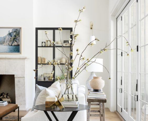 This beautiful light and airy living room has such a fresh, spring feeling! I love the white slipcovered sofa and the beautiful styling on the side table and console table, as well as the beautiful black cabinet! Such a dreamy space! living room ideas - living room design - living room decor - living room furniture