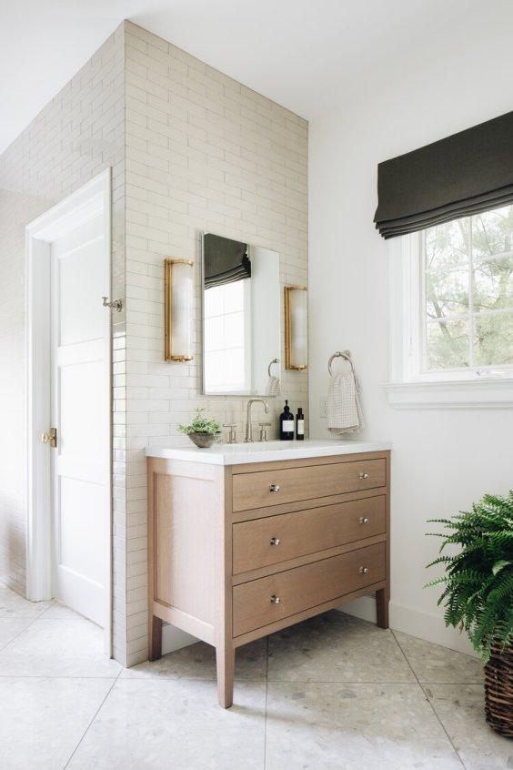 Classic modern bathroom with light wood vanities - jean stoffer design