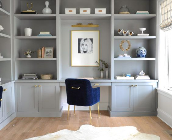 Beautiful home office with blue chair, design with gray built in cabinets and shelves - monika hibbs