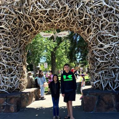 Ally and Aidan at the iconic antler arch in Jackson