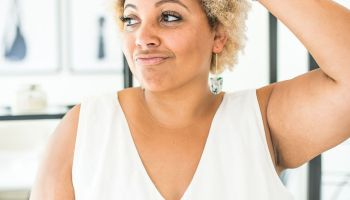 Janelle, creator of Hey J. Nicole, showing earrings as one of her favorite ways to accessorize her short, natural hair known as a TWA