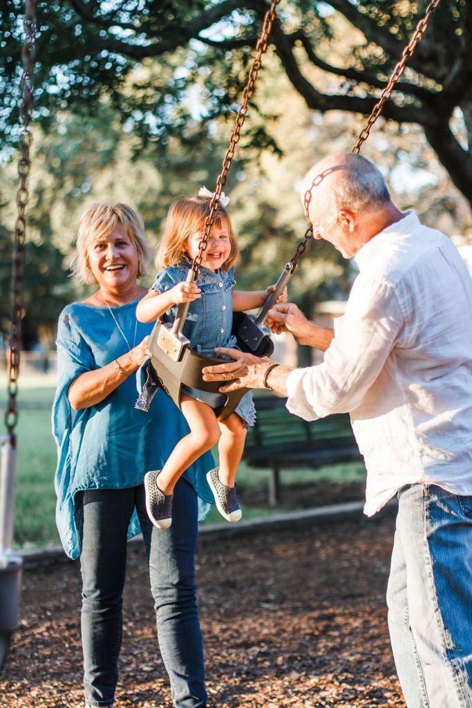 Pushing granddaughter in Pecan Park