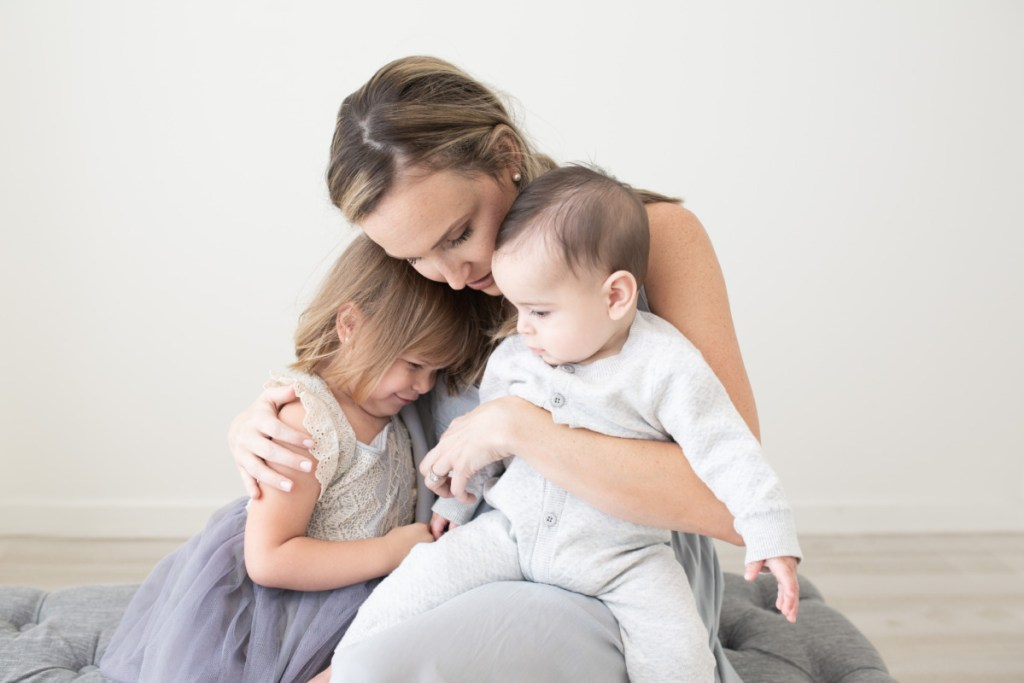 Mom, daughter and son hug, Amy Osborne Photography
