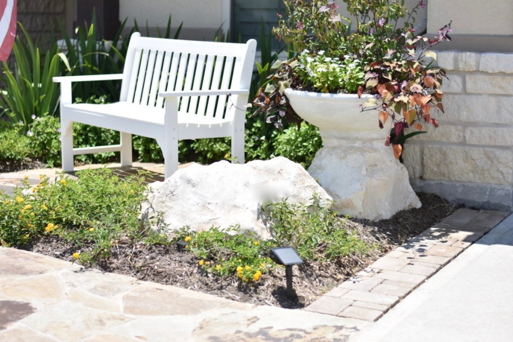 Garden bench, boulder, color bowl