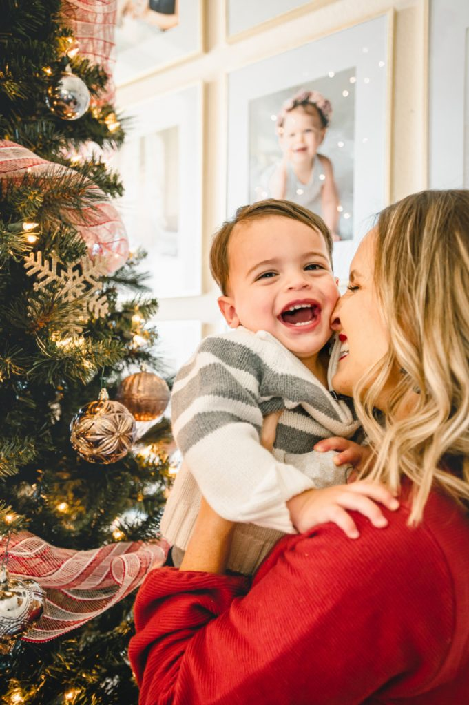Mom and son by Christmas tree