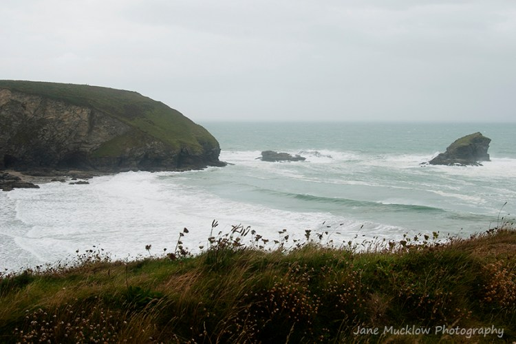View across Portreath bay on a stormy day, by Jane Mucklow Photography