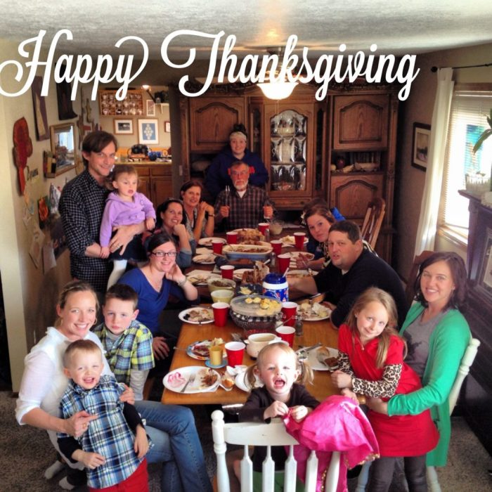 Thanksgiving table with food and family