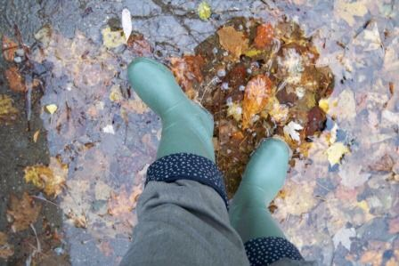 Green rain boots fall leaves train travel tips for Canada women travelers vacation
