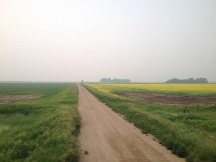 North Dakota, train travel, window views, mist, dirt road