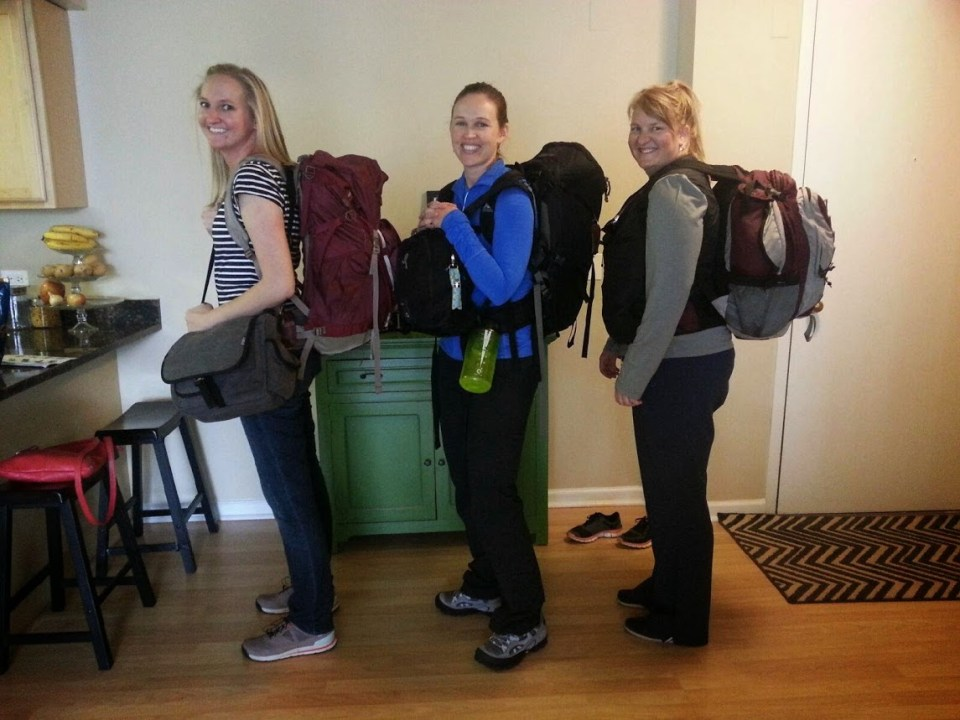 Three female travelers backpack friends vacation