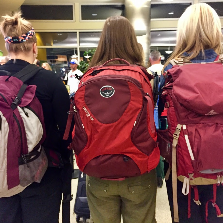 Three red backpacks friends vacation travel