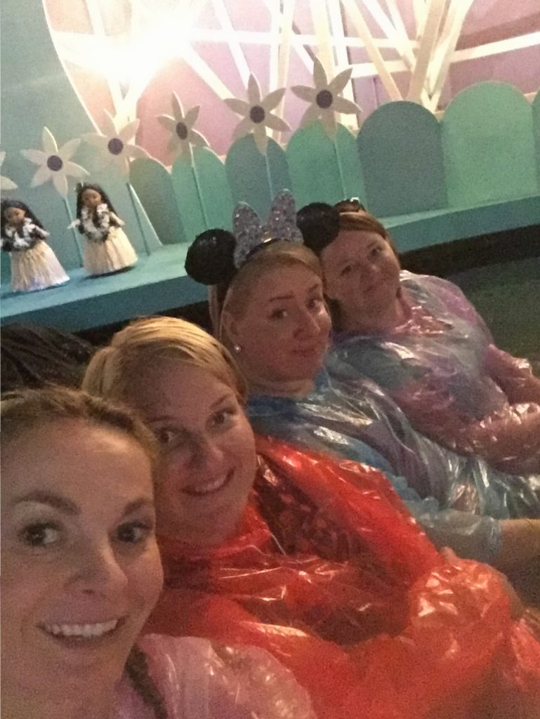 Wearing ponchos on Small World ride at Disney World