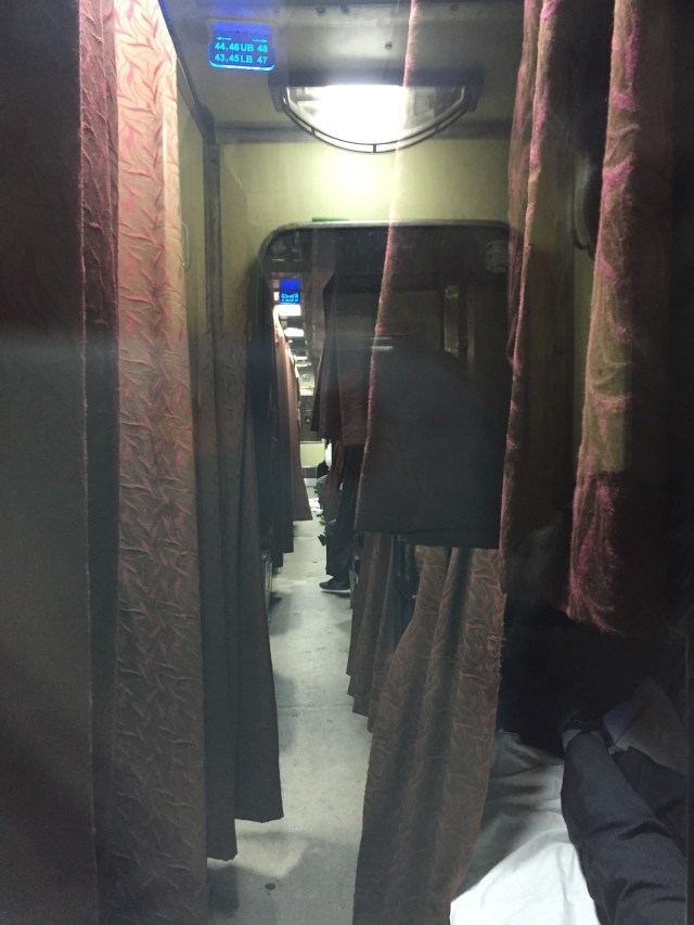 The Aisle of a Train at Night