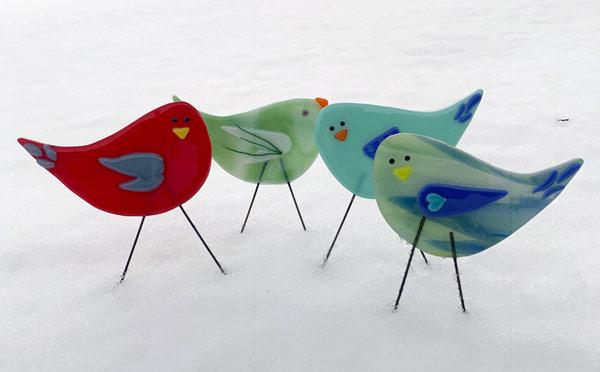 Flock of snowy garden birds by Janet Crosby