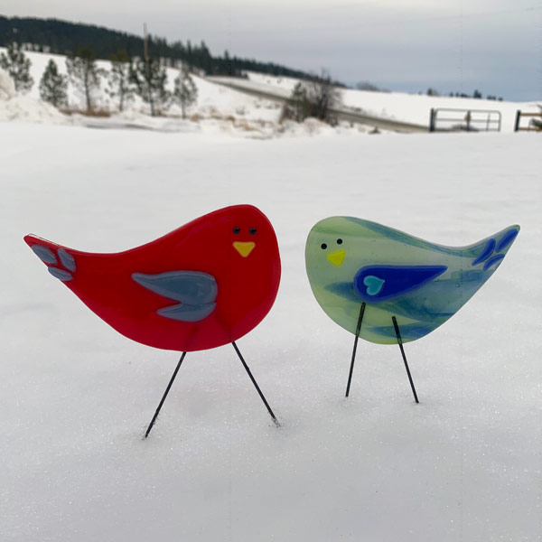 Two birds on a snowy day