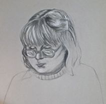 Girl reading, Conté on grey paper.