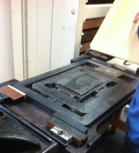 We discovered that this Albion press lacks a coffin, like a chase that fits onto the bed so the plate or chase can be packed in and won't move during printing.