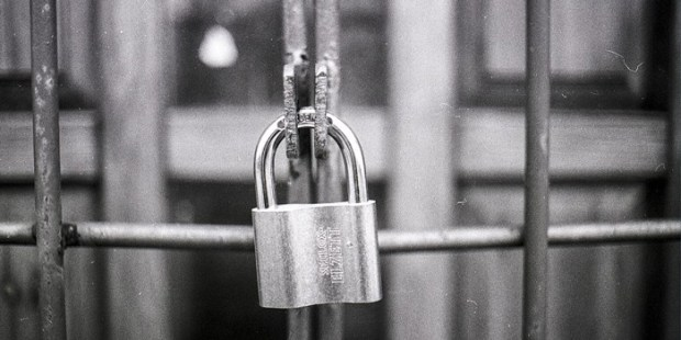 Software for blind: A pad lock locking a fence representing website inaccessibility