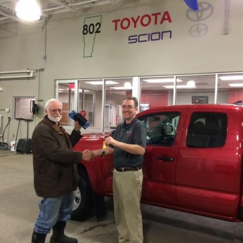 Woody gets the keys from 802 Toyota salesman, Corey Morine