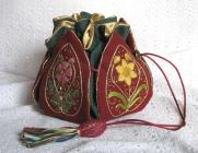A stumpwork embroidery 'Petal Bag'. The design is from the book 'Elizabethan Needlework Accessories'