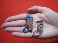'Toys for boys' and 'Toys for girls' doll's house scale miniature needlepoint stocking kits on 40 count silk gauze, available from www.janetgranger.co.uk