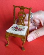 The 'Summer Roses' design on a doll's house scale dining chair. The chair measures just 3 1/2 inches high.