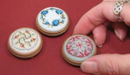 Three doll's house footstools, stitched on 28 count evenweave, available as kits from www.janetgranger.co.uk