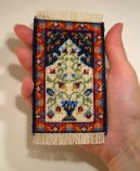 A doll's house scale prayer rug called 'Natalia', available as a kit from www.janetgranger.co.uk