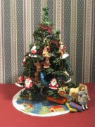 A Christmas tree skirt measuring four inches across, stitched on 32 count silk gauze. Kit available from www.janetgranger.co.uk