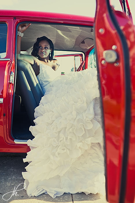 Bride in classic car in Reco Chapple gown