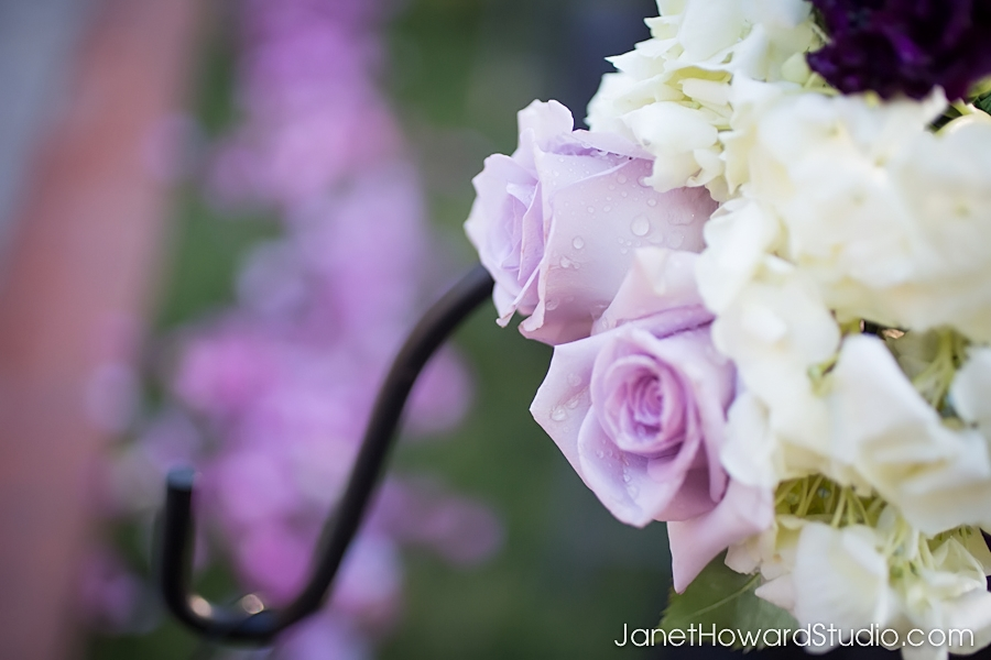 Aisle decor with lanterns and purple petals