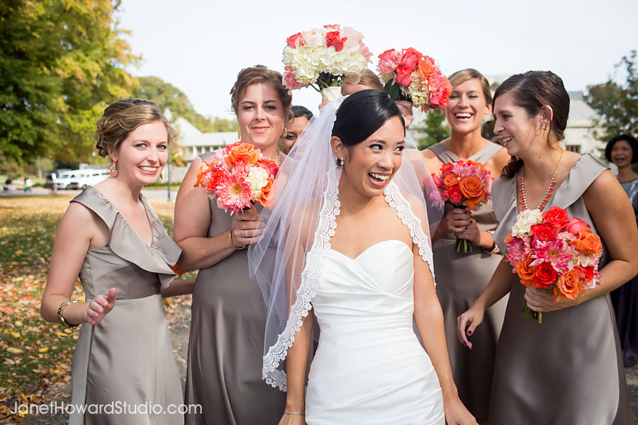 Bridesmaids shielding bride