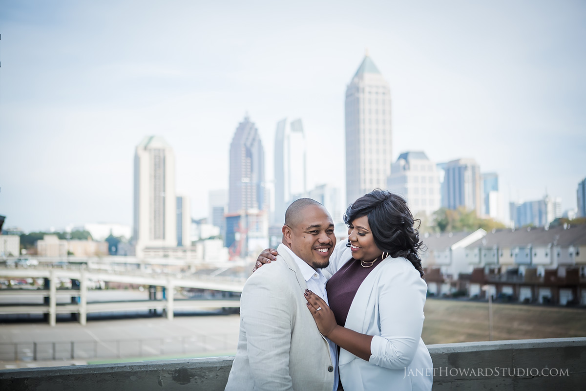 Engagement photos at with view of Atlanta