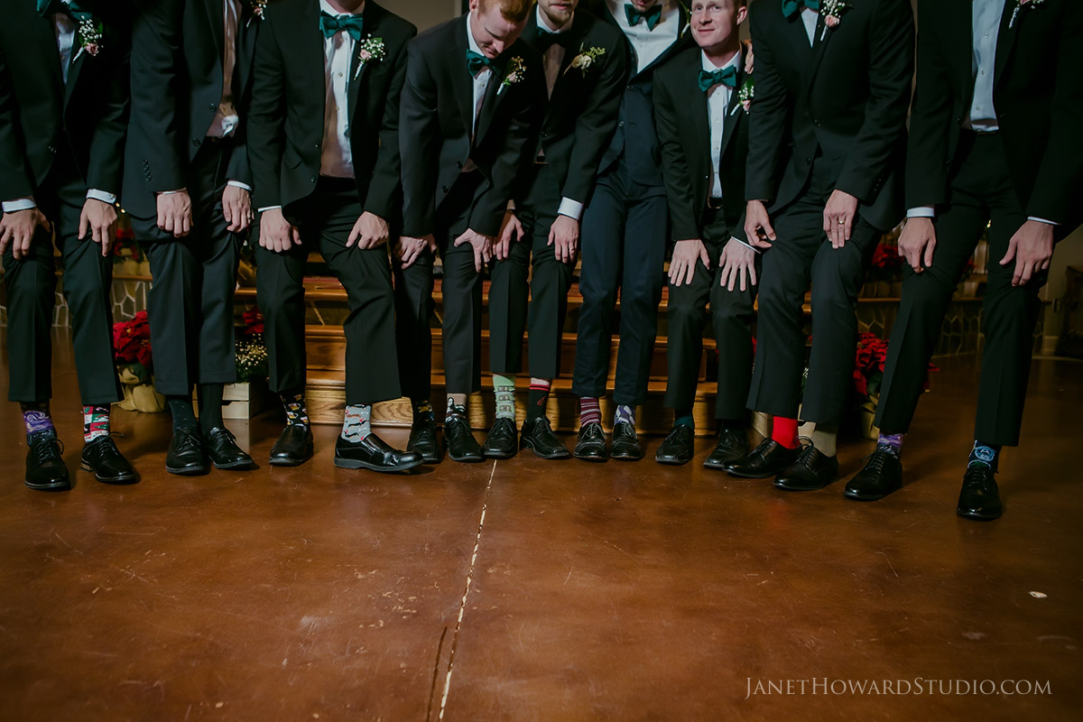 Groomsmen wearing different socks
