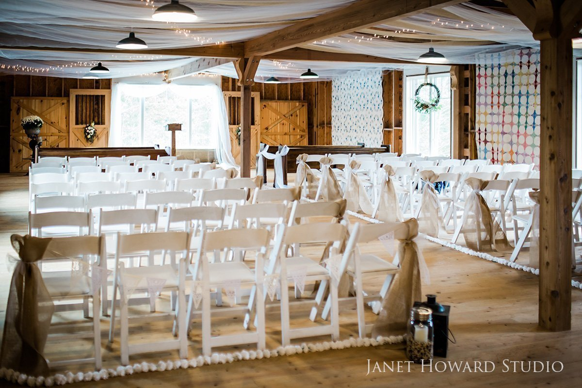 Barn ceremony with quilt decor