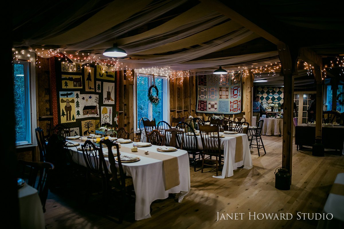 barn wedding reception with quilts