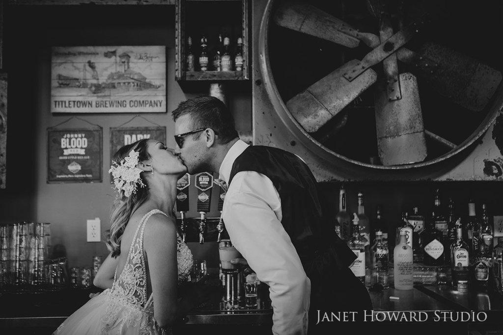 bride and groom at bar