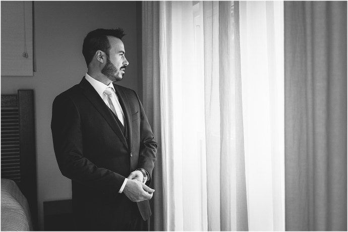 black and white, groom getting ready