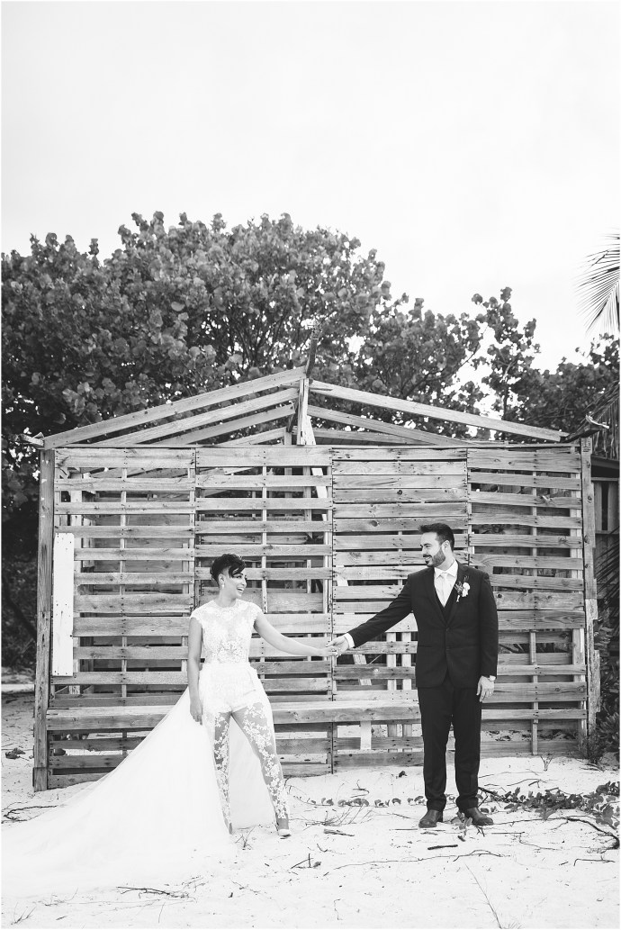 black and white, bride and groom holding hands