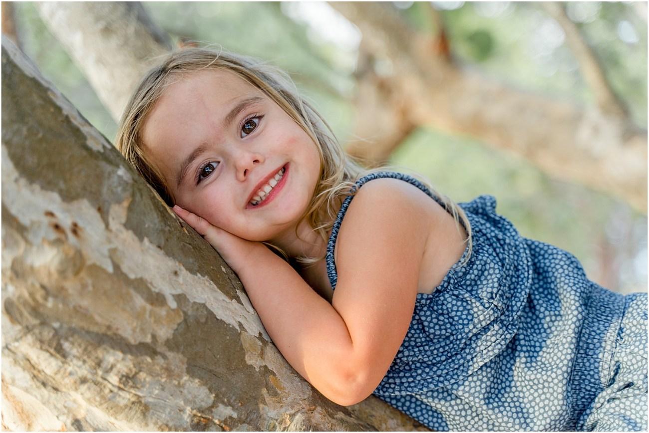 little girl on tree