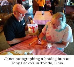 Janet autographing a hotdog bun at Tony Packo's in Toledo, Ohio.