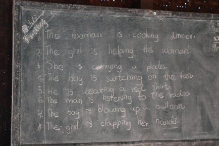An English lesson. They learn to read and write but not speak.