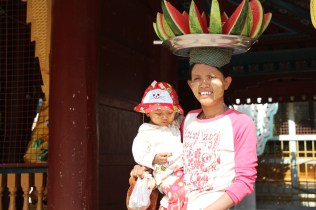 Schwezigon Temple in Bagan -- woman with child and watermelon