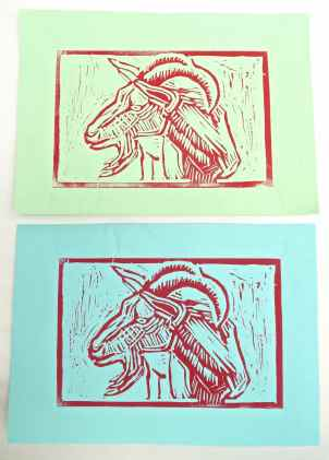 Goat linocut printed on green paper and on blue paper.
